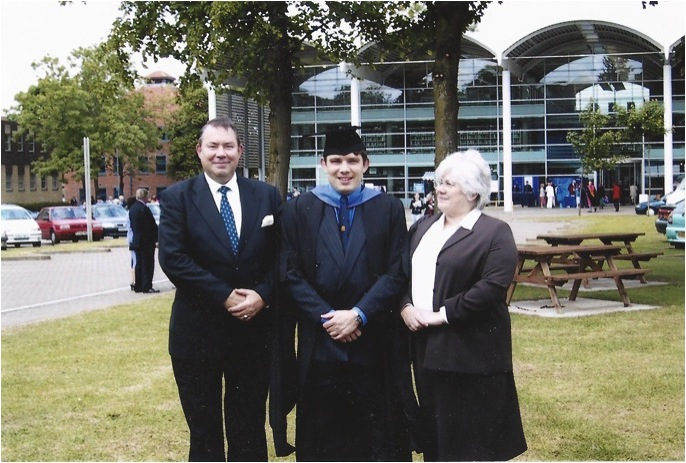 Richard Harpham with mum and dad receiving his Cranfield MBA